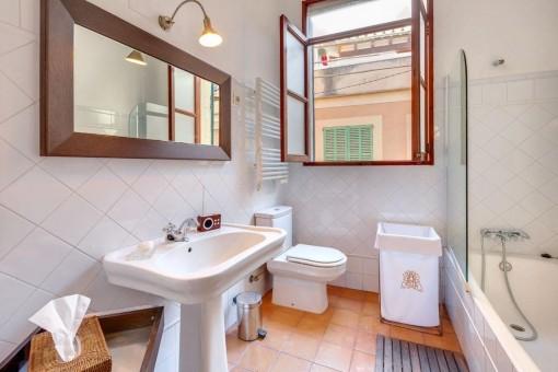 Bathroom with bathtub and natural light