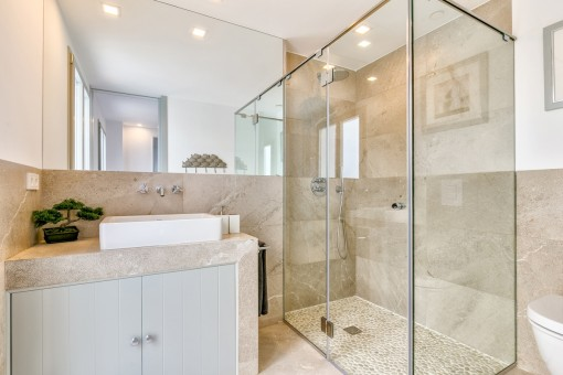 Mediterranean bathroom with walk-in shower
