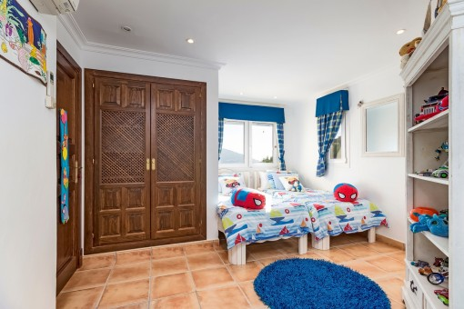 Capacious children's room with 2 single beds
