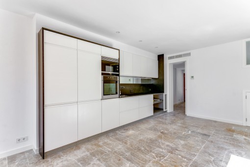 Spacious kitchen with possible dining area and access to the terrace