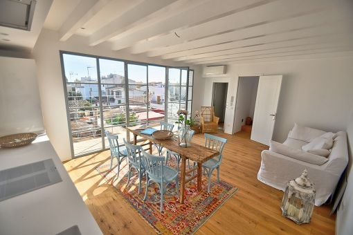 The living area has large panorama windows and offers access to a balcony
