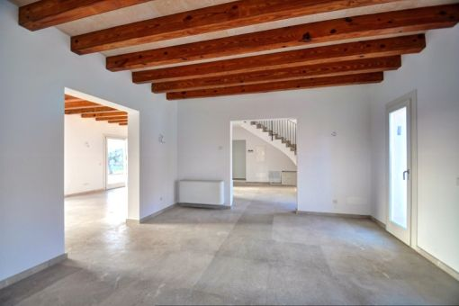 Dining area with wooden ceiling beams