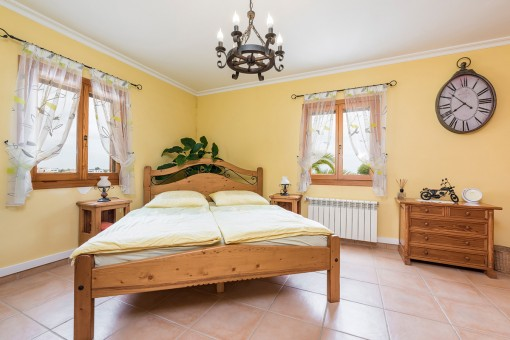 Spacious bedroom with double bed and a chandelier