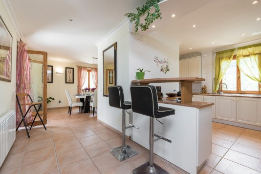 Views of the open plan kitchen with stools and a counter