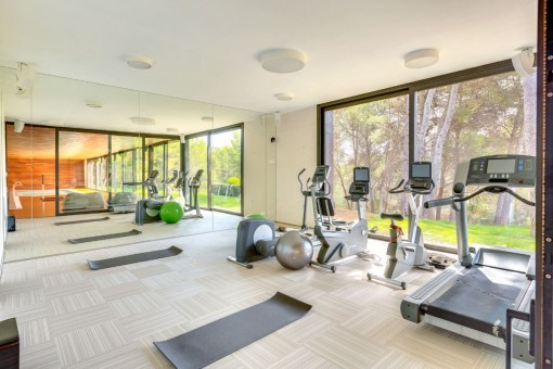 Gym with garden views