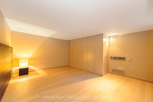 Large bedroom with built-in wardrobe