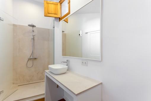 Modern bathroom with small window
