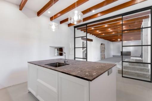 Adjoining kitchen with kitchen island