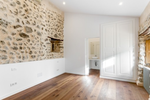Bedroom with natural stone wall