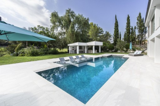 Pool with integrated sun loungers
