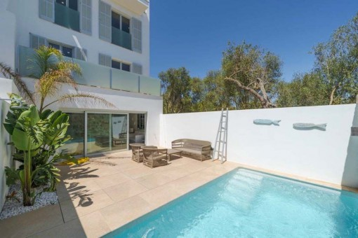 Exclusive town-house with first-class construction quality, with pool and sea views in Porto Colom