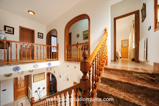 A marble staircase leads up from the ground floor to the first floor