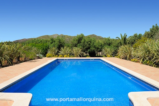 The swimming pool is surrounded by picturesque scenery