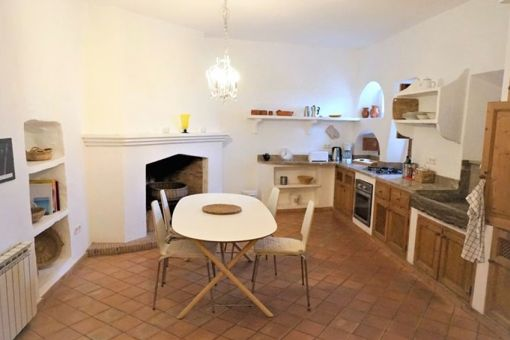 Cosy kitchen with dining area and fireplace