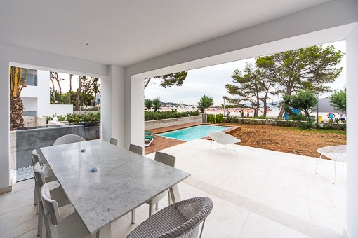 Recently completed ground floor apartment on the 1st sea line on the sandy beach of Alcudia