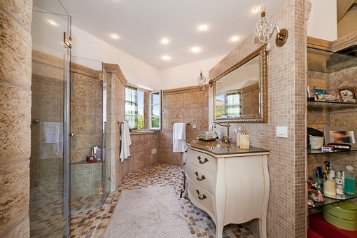 Natural stoned bathroom with large shower