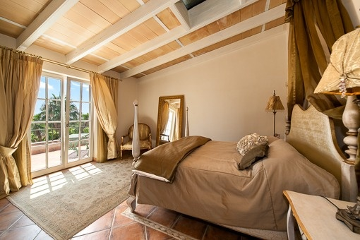 Decorative bedroom with pitched roof and balcony access
