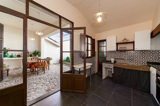 Traditional kitchen with access to the patio