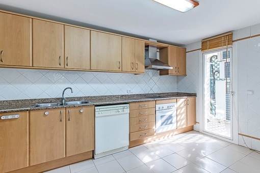 Fully-equipped kitchen with access to terrace