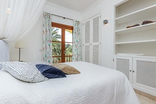 Bedroom with built-in wardrobe