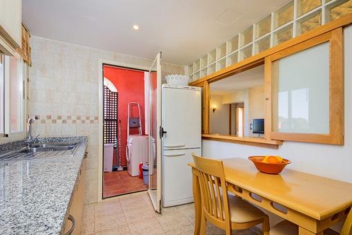 Kitchen with storage room