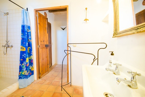 One of two bathrooms with shower