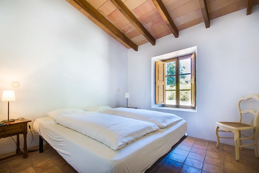Spacious bedroom with wooden beam ceiling