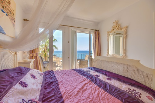 Bedroom with direct sea views