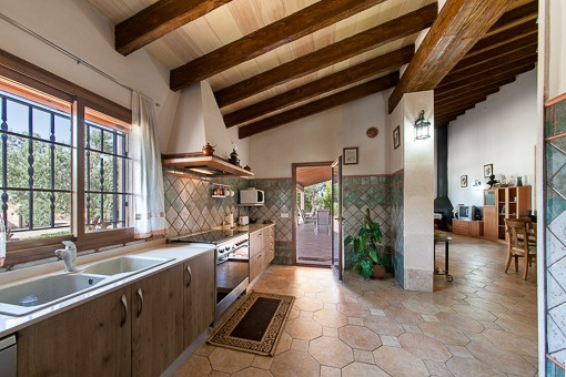Kitchen in rustic style with access to terrace