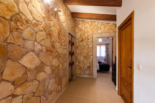 Natural stone walls and original ceiling beams