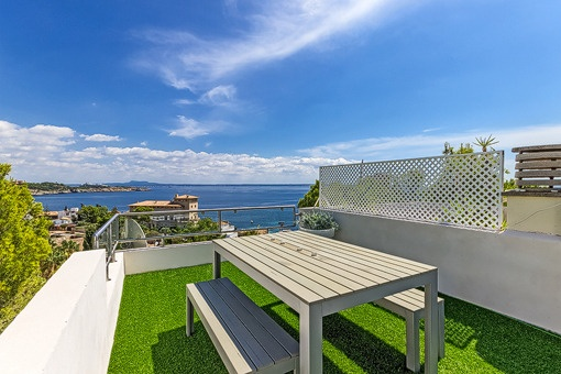 Modern duplex apartment with fantastic sea views and private roof terrace in Cas Català