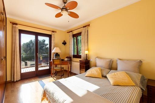 Bright bedroom with balcony access
