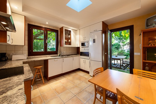 Kitchen with garden views and dining area