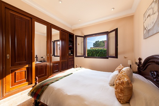 Elegant master bedroom with built-in wardrobe