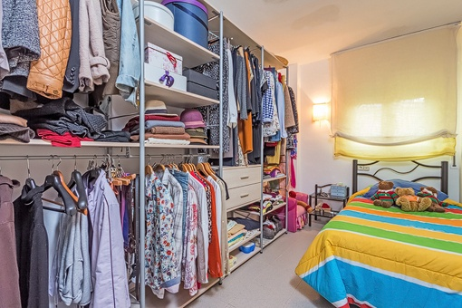 Guest bedroom with spacious wardrobe
