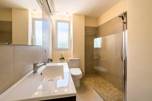 One of 2 modern bathrooms