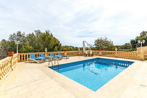 Ample pool area with terrace