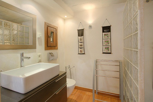 Bathroom with glass wall