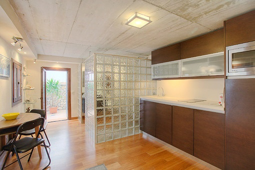 Modern kitchen with dining table