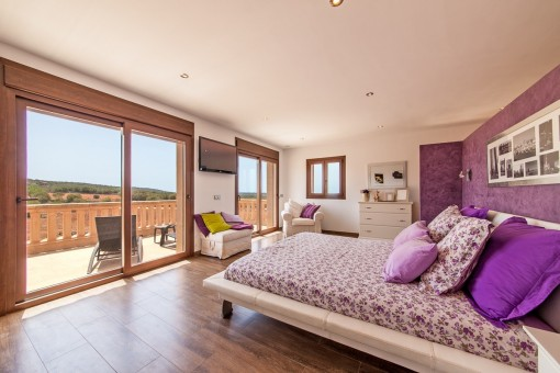 Bedroom with panoramic windows and balcony