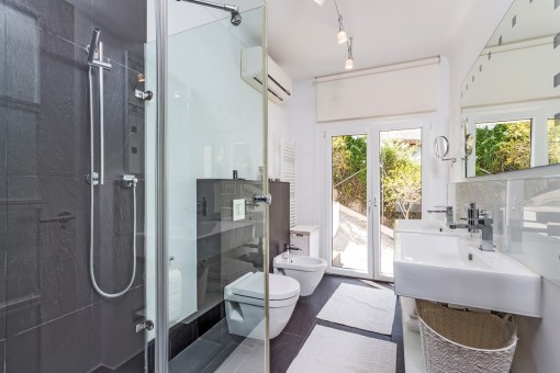 Guest bathroom with large windows