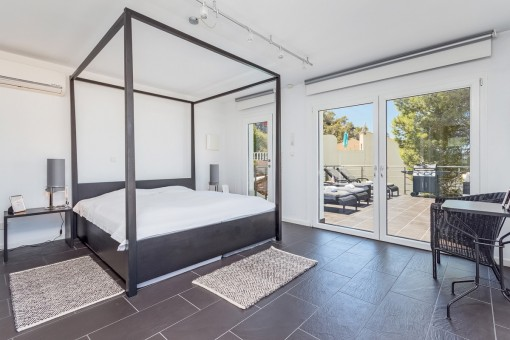 Modern bedroom with access to terrace