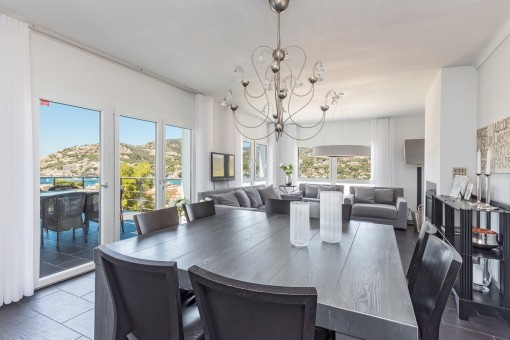 Stylish dining area with lovely sea views and access to terrace