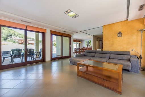 Large living area with access to terrace