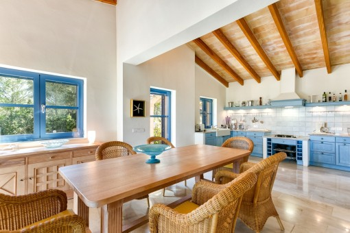 Beautiful dining area with open country-style kitchen