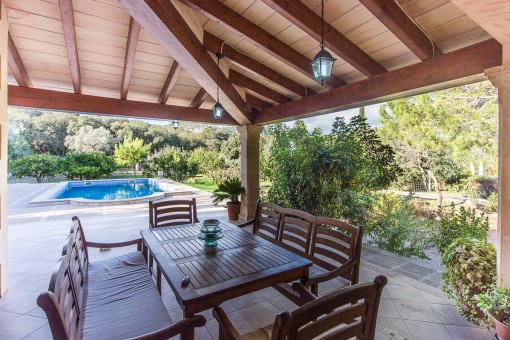 Dining area on the terrace with garden and pool views