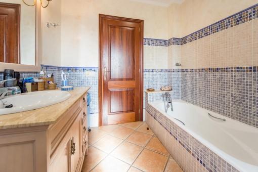 Bright bathroom with bathub