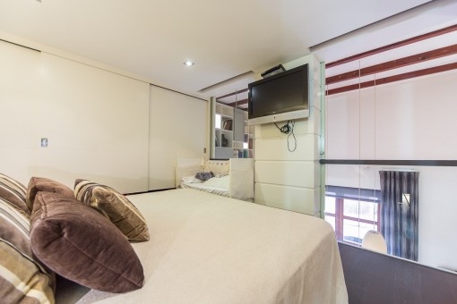 Cosy bedroom with built-in wardrobe and gallery