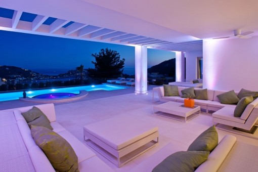 Views from the lounge area to the pool by night