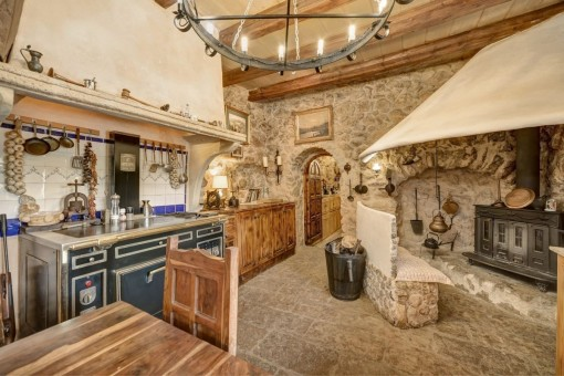 Fully equipped kitchen with fireplace